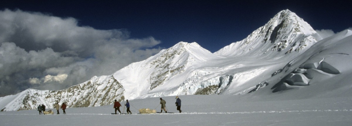High altitude porters descending equipment and ice cores from the Dasuopu ice core drilling site.