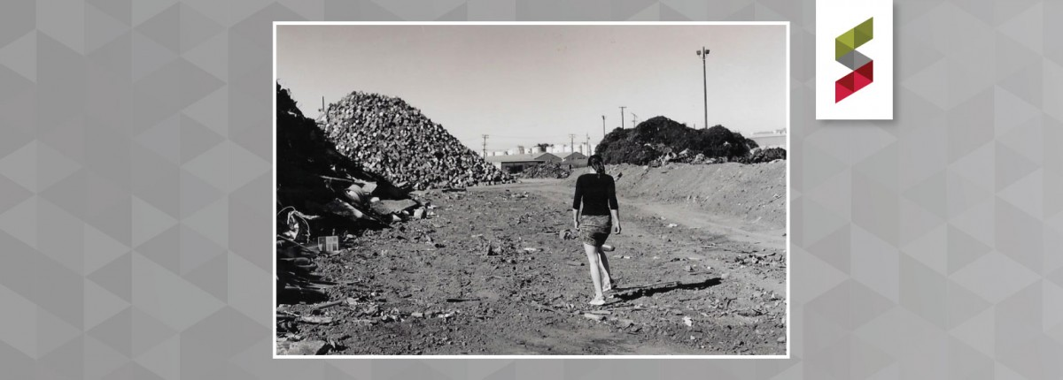 woman walking on industrial cleanup site