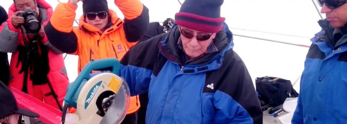 Lonnie Thompson cuts an ice core retrieved from the Guliya Ice Cap in the Kunlun Mountains in Tibet in 2015.