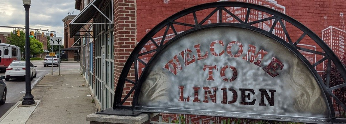A welcome to Linden community sign.